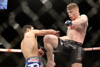 LAS VEGAS, NV - JANUARY 03: Paul Felder (R) kicks at Danny Castillo in a lightweight bout during the UFC 182 event in the MGM Grand Garden Arena on January 3, 2015 in Las Vegas, Nevada. Felder won with a second-round knockout. (Photo by Steve Marcus/Getty Images)
