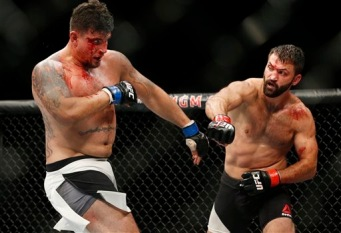 Andrei Arlovski, right, fights Frank Mir during their heavyweight mixed martial arts bout at UFC 191 on Saturday, Sept. 5, 2015, in Las Vegas. (AP Photo/John Locher)