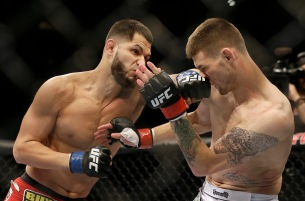 Jorge Masvidal, left, punches Tim Means during the first round of a UFC lightweight mixed martial arts fight in San Jose, Saturday, April 20, 2013. Masvidal won by unanimous decision. (AP Photo/Jeff Chiu)