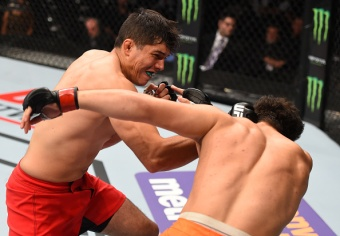 MONTERREY, MEXICO - NOVEMBER 21: (L-R) Alvaro Herrera of Mexico knocks out Vernon Ramos of Panama in their welterweight bout during the UFC Fight Night event at Arena Monterrey on November 21, 2015 in Monterrey, Mexico. (Photo by Jeff Bottari/Zuffa LLC/Zuffa LLC via Getty Images)
