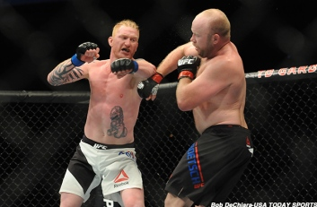 Jan 17, 2016; Boston, MA, USA; Ed Herman (blue) punches Tim Boetsch (red) during a middleweight bout at UFC Fight Night at the TD Garden. Herman won in the second round with a knock-out. Mandatory Credit: Bob DeChiara-USA TODAY Sports