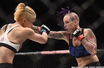 Mar 20, 2015; Brisbane, Australia; Bec Rawlings (red gloves) competes against Seohee Ham (blue gloves) during UFC Fight Night at Brisbane Entertainment Centre. Mandatory Credit: Matt Roberts-USA TODAY Sports