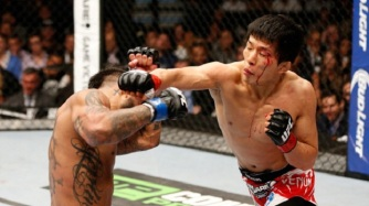 LAS VEGAS, NV - MAY 24: (R-L) Takeya Mizugaki punches Francisco Rivera in their bantamweight bout during the UFC 173 event at the MGM Grand Garden Arena on May 24, 2014 in Las Vegas, Nevada. (Photo by Josh Hedges/Zuffa LLC/Zuffa LLC via Getty Images)