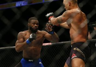 Jul 30, 2016; Atlanta, GA, USA; Robbie Lawler (red gloves) competes against Tyron Woodley (blue gloves) for the world welterweight championship during UFC 201 at Phillips Arena. Mandatory Credit: Butch Dill-USA TODAY Sports