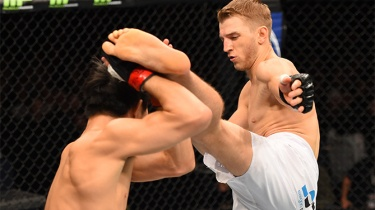 ADELAIDE, AUSTRALIA - MAY 10: (R-L) Daniel Hooker kicks Hatsu Hioki in their featherweight bout during the UFC Fight Night event at the Adelaide Entertainment Centre on May 10, 2015 in Adelaide, Australia. (Photo by Josh Hedges/Zuffa LLC/Zuffa LLC via Getty Images)