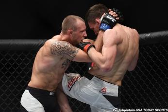 Sep 3, 2016; Hamburg, Germany; Jack Hermansson (blue gloves) competes against Scott Askham (red gloves) during UFC Fight Night at Barclaycard Arena. Mandatory Credit: Per Haljestam-USA TODAY Sports