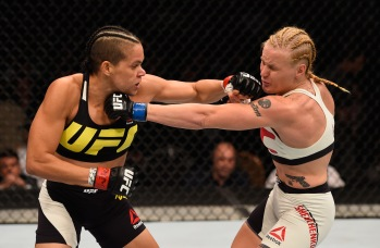 LAS VEGAS, NV - MARCH 05: (L-R) Amanda Nunes of Brazil punches Valentina Shevchenko of Peru in their women's bantamweight bout during the UFC 196 event inside MGM Grand Garden Arena on March 5, 2016 in Las Vegas, Nevada. (Photo by Josh Hedges/Zuffa LLC/Zuffa LLC via Getty Images)