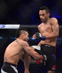 May 14, 2016; Curitiba, Brazil; Rob Font (blue) attempts a knee to the face of John Lineker (red) during UFC Fight Night at Arena Atletico Paranaense. Mandatory Credit: Jason Silva-USA TODAY Sports