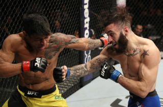 ALBANY, NY - DECEMBER 09: (R-L) Shane Burgos and Tiago Trator of Brazil trade punches in their featherweight bout during the UFC Fight Night event at the Times Union Center on December 9, 2016 in Albany, New York. (Photo by Patrick Smith/Zuffa LLC/Zuffa LLC via Getty Images)