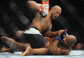December 12, 2015; Las Vegas, NV, USA; Ronaldo Souza lands punches against Yoel Romero during UFC 194 at MGM Grand Garden Arena. Mandatory Credit: Gary A. Vasquez-USA TODAY Sports