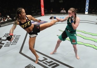 ALBANY, NY - DECEMBER 09: (L-R) Juliana Lima of Brazil kicks JJ Aldrich in their womens strawweight bout during the UFC Fight Night event at the Times Union Center on December 9, 2016 in Albany, New York. (Photo by Patrick Smith/Zuffa LLC/Zuffa LLC via Getty Images)