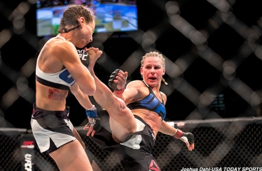 Jan 2, 2016; Las Vegas, NV, USA; Justine Kish (red gloves) competes against Nina Ansaroff (blue gloves) during UFC 195 at MGM Grand Garden Arena. Mandatory Credit: Joshua Dahl-USA TODAY Sports