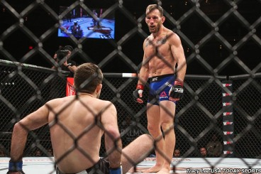 Dec 3, 2016; Las Vegas, NV, USA; Ryan Hall (blue gloves) down on the mat during his fight against Gray Maynard (red gloves) during the TUF tournament of champions at Palms Casino. Mandatory Credit: Tracy Lee-USA TODAY Sports