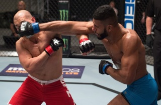 LAS VEGAS, NV - FEBRUARY 07: (R-L) Dhiego Lima punches Hayder Hassan during the filming of The Ultimate Fighter: Redemption at the UFC TUF Gym on February 7, 2017 in Las Vegas, Nevada. (Photo by Brandon Magnus/Zuffa LLC/Zuffa LLC via Getty Images)