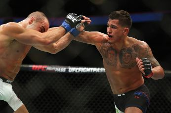 BOSTON, MA - JANUARY 17: Anthony Pettis (R) punches Eddie Alvarez in their lightweight bout during UFC Fight Night 81 at TD Banknorth Garden on January 17, 2016 in Boston, Massachusetts. (Photo by Maddie Meyer/Getty Images)